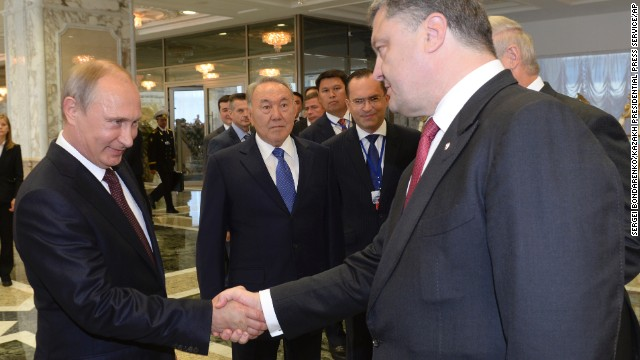 Presidents Vladimir Putin and Petro Poroshenko shake hands after talks in Belarus on Tuesday.