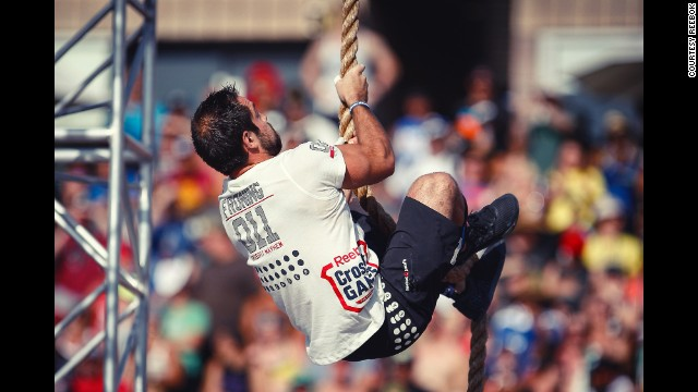 Froning does a rope climb during the <a href='http://games.crossfit.com/workouts/games' target='_blank'>Thick N' Quick event</a>. Athletes had to do four rope climbs and three overhead squats with 165 pounds in under 4 minutes.