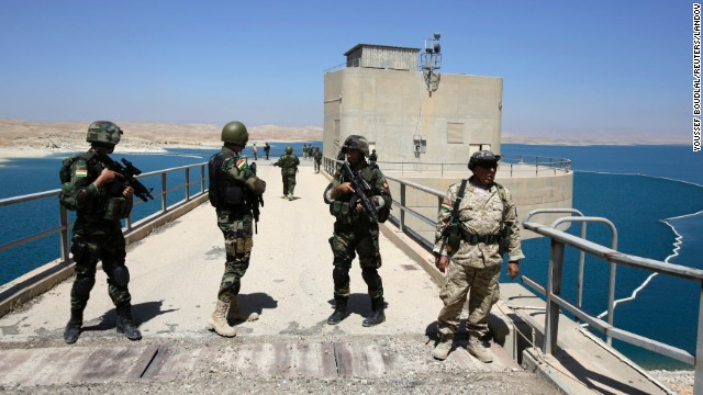 Peshmerga fighters stand guard at Mosul Dam in northern Iraq on Thursday, August 21. With the help of U.S. military airstrikes, Kurdish and Iraqi forces<a href='http://www.cnn.com/2014/08/18/world/meast/iraq-mosul-dam/index.html'> retook the dam</a> from ISIS militants on August 18. A breach of the dam would have been catastrophic for millions of Iraqis who live downstream from it.