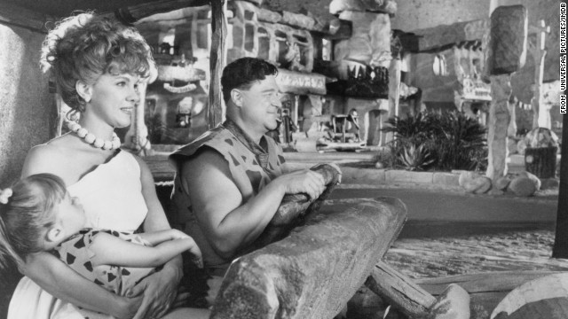 Flintstones, meet the Flintstones ... in non-animated form: The live-action movie starring John Goodman, Elizabeth Perkins, Rick Moranis and Rosie O'Donnell made its big-screen debut on May 27. Despite negative reviews, the film was a box-office success.