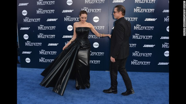 "Jolie and Pitt arrive at the premiere of Jolie's ""Maleficent"" at the El Capitan Theatre in Hollywood on May 28."