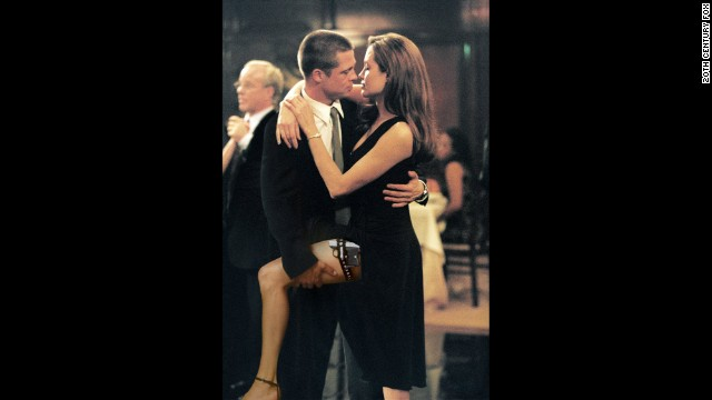 "Pitt and Jolie get close in a scene from their first film together, ""Mr. and Mrs. Smith,"" in 2005."