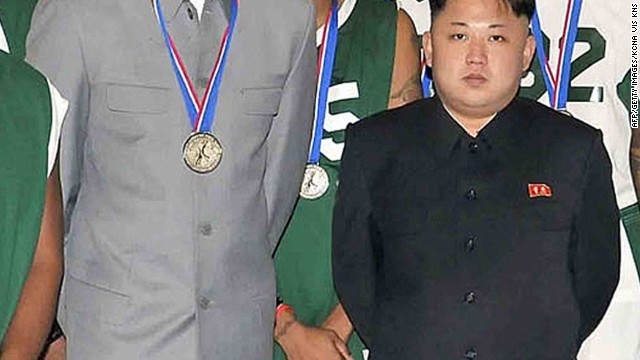 This photo taken on January 8 shows Rodman and Kim with other former NBA players at Pyongyang Gymnasium in Pyongyang.