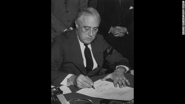U.S. President Franklin D. Roosevelt signs the declaration of war against Japan on December 8, 1941. After it was signed, the two other Axis powers, Italy and Germany, immediately declared war on the United States. On December 11, Roosevelt signed the U.S. declarations of war against Germany and Italy.