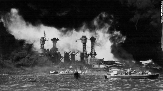 A view of U.S. ships in Pearl Harbor, Hawaii, after the Japanese attack on December 7, 1941. The USS West Virginia and USS Tennessee are in the foreground. The attack destroyed more than half the fleet of aircraft and damaged eight battleships. Japan also attacked Clark and Iba airfields in the Philippines, destroying more than half the U.S. Army's aircraft there.