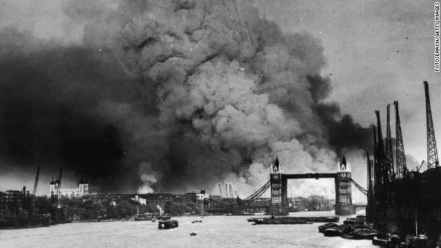 Smoke rises behind Tower Bridge during the first mass daylight attack in London on September 7, 1940. The nightly German air raids over London became known as the Blitz.