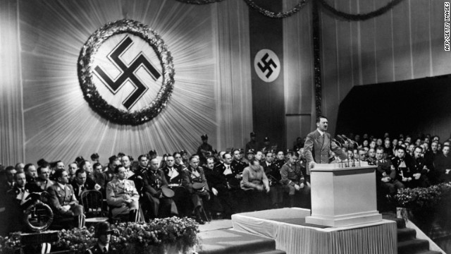 A 1939 photo shows German Chancellor Adolf Hitler speaking to Nazi officials.