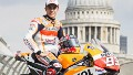 Marc Marquez of Spain and Repsol Honda Team poses with his bike at a photocall on the Millennium Bridge during previews for the MotoGp Of Great Britain, on August 27, 2014 in London, United Kingdom.