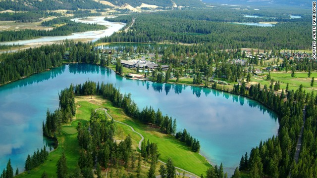 Overlooking a pristine green lake, the 14th tee at Fairmont Jasper Park Lodge requires a gutsy drive over water and through well-placed pine trees.