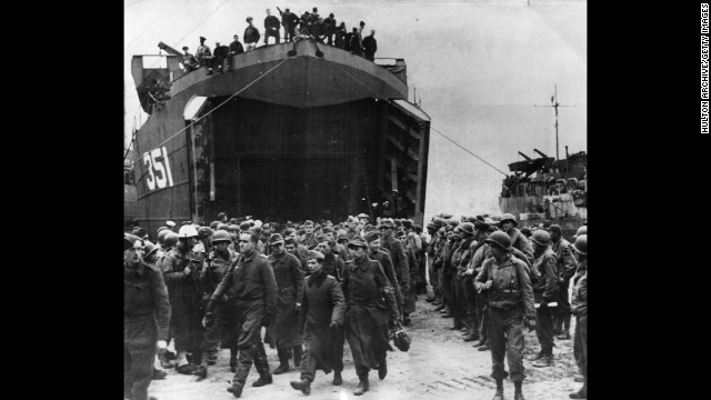German prisoners captured at the beachhead of Anzio leave a landing craft on their way to a prison camp in 1944. The amphibious landing and ensuing battle helped Allied forces break a months-long stalemate south of Rome and ultimately defeat the Germans in Italy.