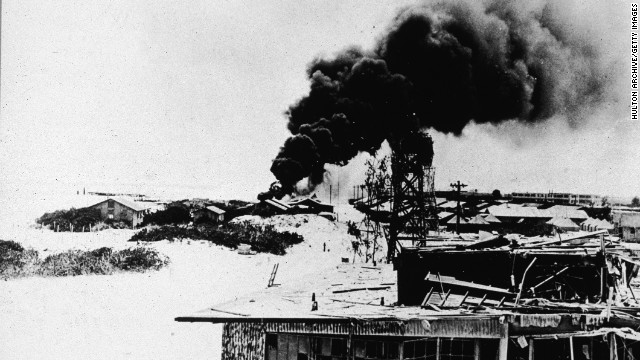 Black smoke rises from demolished buildings after Japanese air forces attacked the U.S. Navy base on Midway Atoll during the Battle of Midway in June 1942. The four-day battle became a major victory for the U.S. Navy, which sunk four Japanese aircraft carriers, and it marked a major turning point in the war in the Pacific.