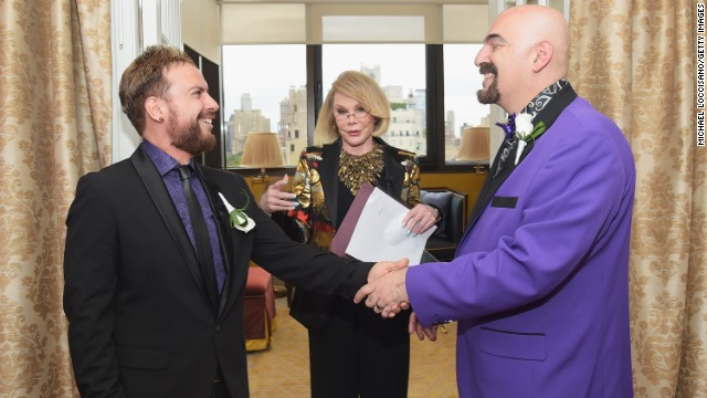 "Rivers officiates the wedding of William ""Jed"" Ryan, left, and Joseph Aiello at the Plaza Athenee on August 15 in New York."