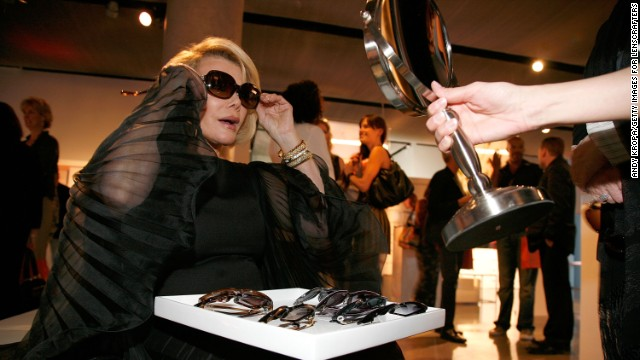 Rivers, a fashion lover, attends the LensCrafters' reveal of Sunglass Fashion Crimes in 2011.