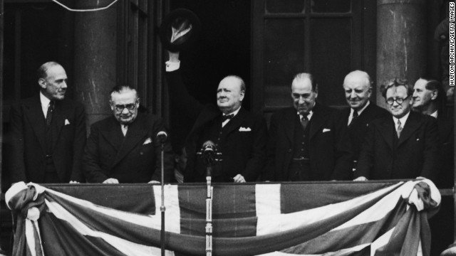 British Prime Minister Winston Churchill addresses the celebrating crowds from the balcony of the Ministry of Health in Whitehall, London, on V-E Day, May 8, 1945. The war in Europe is officially over.