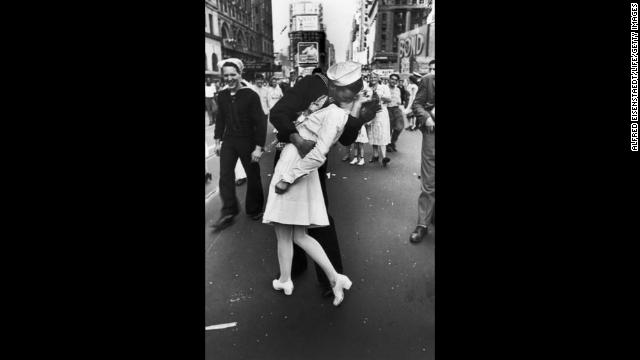 V-J Day: A jubilant American sailor hugs a nurse as he celebrates the news that Japan has surrendered, on August 14, 1945, with thousands of others in New York's Times Square.