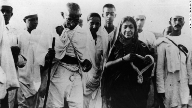 On March 12, 1930, Indian nationalist leader Mahatma Gandhi led a nonviolent protest against the British Empire. The march protested the British tax on salt, a necessity of everyday life. Gandhi called for Indians to illegally make salt or buy it illegally. More nonviolent protests against the tax were mounted in large cities across India and Gandhi's methods eventually led to India's independence. Shown, Gandhi and politician Mrs. Sarojini Naidu, with a garland, during the Salt March.