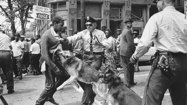 A 17-year-old civil rights demonstrator, defying an anti-parade ordinance in Birmingham, Alabama, is attacked by a police dog on May 3, 1963.