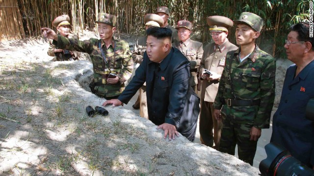 "North Korean leader Kim Jong-un, center, tours a frontline military unit, in this image released July 16 by state run North Korean Central News Agency. A recent United Nations report described a brutal North Korean state ""that does not have any parallel in the contemporary world."""
