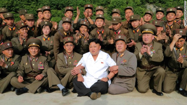 Kim poses for a photo as he oversees a tactical rocket-firing drill in June.