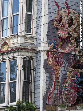 A professional mural illustrates the side of an antique house in San Francisco's Haight-Ashbury neighborhood.