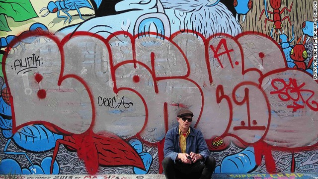 """Mats Stromberg (pictured) completed his """"Giant Selfie"""" mural in San Francisco's Mission District in 2013, but blobs of silver-colored letters outlined in red, spelling the name """"Blake,"""" smothered much of it in July."""