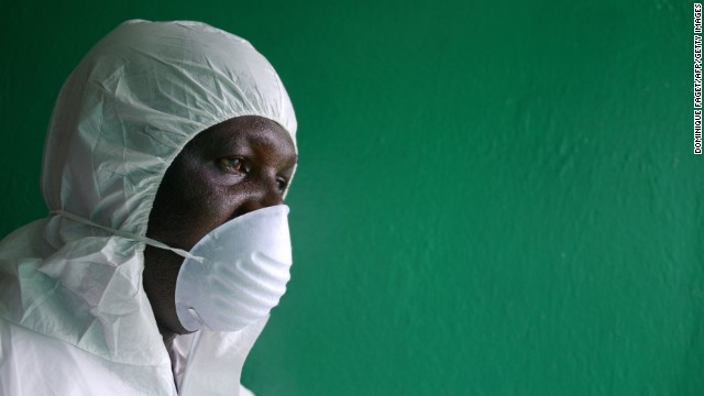 A health worker wearing a protective suit conducts an Ebola prevention drill at the port in Monrovia on August 29.