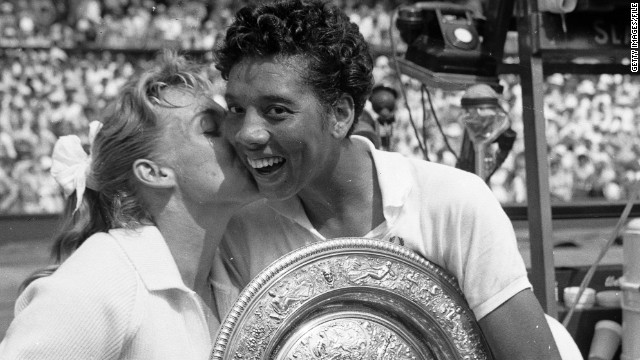 Gibson (right) receives a kiss from compatriot Darlene Hard, who she beat to become the first black woman to win the Wimbledon title in 1957.