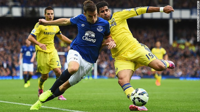 Chelsea striker Diego Costa battles with Everton's Seamus Coleman during the Premier League match at Goodison Park.