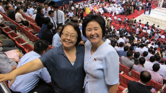 The woman on the left is a blogger living in South Korea and the woman on the right lives in North Korea. Both attended a pro-wrestling festival in Pyongyang.
