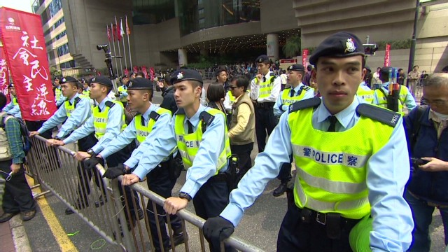 Police ready for demonstrations on August 31, 2014, following an announcement from Beijing that Hong Kong will not have fully open elections.