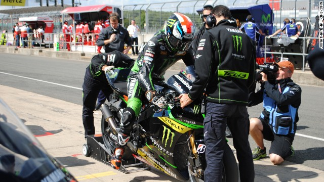 Tech3 Yamaha's British rider Bradley Smith was forced into the pits after his rear wheel rim broke. He rejoined the race and managed to get within a lap of the pack, to loud cheers from the home crowd.