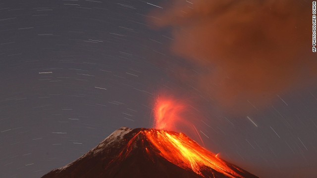 "SEPTEMBER 1 - BANOS, ECUADOR: The Tungurahua volcano spews ash and stones during an eruption on August 31. <a href='http://cnn.com/2011/WORLD/americas/04/26/ecuador.volcano/'>Tungurahua, which translates as ""Throat of fire"" in the native Quechua language, has erupted periodically since 1999. </a>"