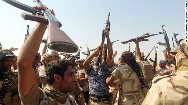 Iraqi volunteer fighters on Monday, September 1, celebrate the breaking of the siege on the Shiite town of Amerli as they advance toward the town from the south. ISIS militants had surrounded Amerli, 70 miles north of Baquba, since mid-June.