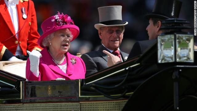 June 20, 2014: Queen Elizabeth II and Prince Philip arrive on day four of Royal Ascot horse race in Ascot, England.