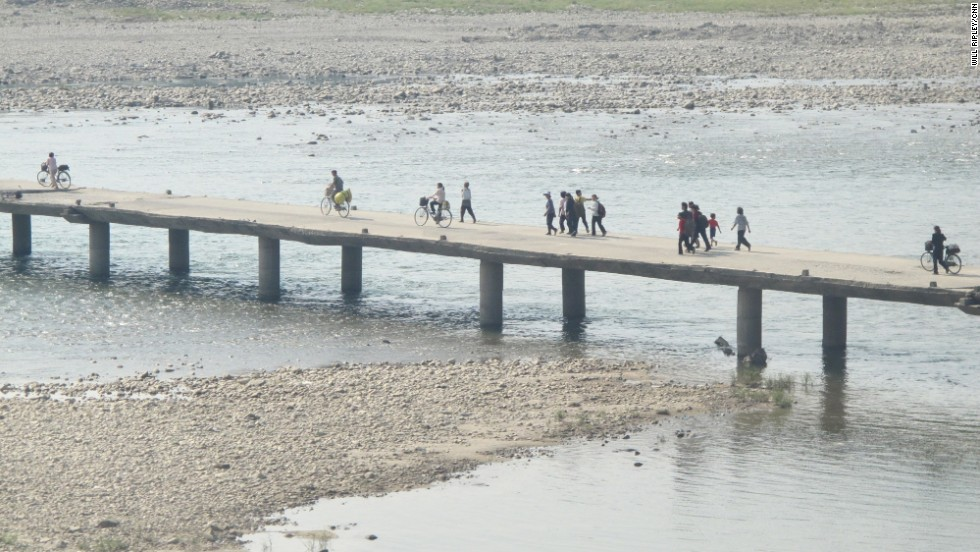 "NORTH KOREA: ""People stream across this precarious bridge in North Pyongan Province. Our minders tell us that this area was heavily hit by floods last year and several other bridges were washed away."" - CNN's Will Ripley, September 1. For more captures from North Korea, follow Will (<a href='http://instagram.com/willripleycnn' target='_blank'>@willripleycnn</a>) & CNN's Tim Schwarz (<a href='http://instagram.com/tjschwarz' target='_blank'>@tjschwarz</a>) along on Instagram."
