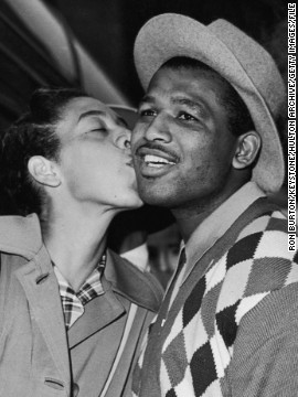 Gibson greets Sugar Ray Robinson on his arrival in London in 1957. The American boxing legend and his wife were early benefactors in Gibson's life, helping fund her tennis career as a teenager.