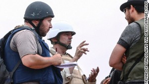 American journalist Steven Sotloff, left, talks to Libyan rebels on the Al Dafniya front line in Misrata, Libya, in June 2011.