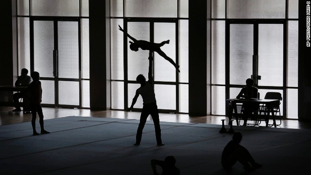 SEPTEMBER 2 - PYONGYANG, NORTH KOREA: Gymnasts practice their routines for the Asian Games in Incheon, South Korea. Beginning on September 19 and held every four years, the competition is said to be<a href='http://www.ocasia.org/game/GamesL1.aspx?9QoyD9QEWPeJ2ChZBk5tvA==' target='_blank'> the biggest multi-sport event after the Olympic Games. </a>