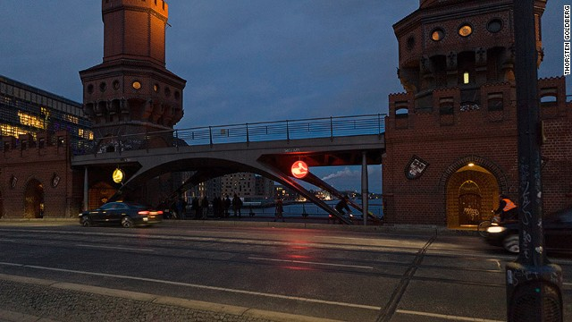 """Rock, Paper, Scissors"" lights up in neon every six seconds to reflect the significance of the Oberbaumbrucke bridge connecting Kreuzberg and Friedrichshain, former boroughs that were separated by the Berlin Wall."