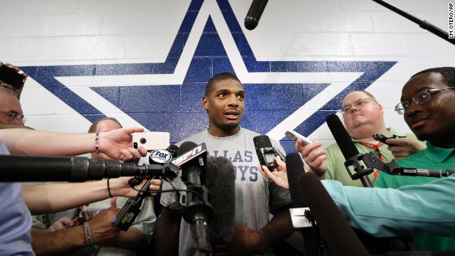 Michael Sam speaks to reporters Wednesday, September 3, after practicing at the Dallas Cowboys' headquarters in Irving, Texas. Sam, who made history as the first openly gay player to be drafted into the NFL, did not make the St. Louis Rams' final 53-man roster, but he was signed by the Cowboys to be on their practice squad.