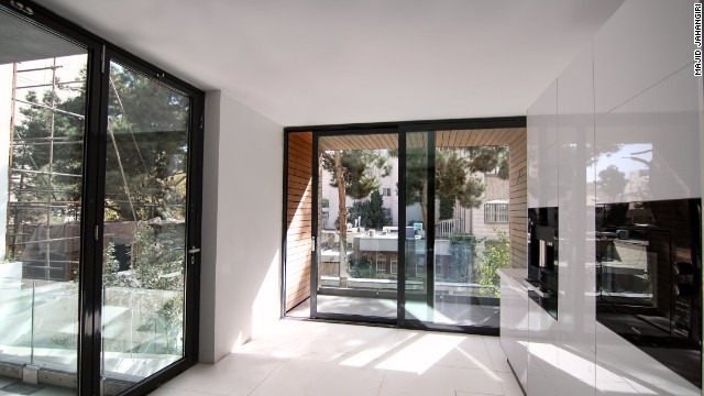 When open, the house is flooded with light through the front facade.