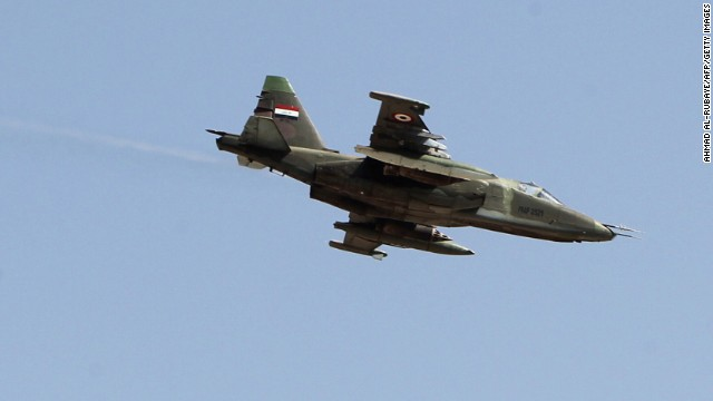 An Iraqi fighter jet flies over Amerli, Iraq, on September 3. Amerli had been under siege by ISIS militants.
