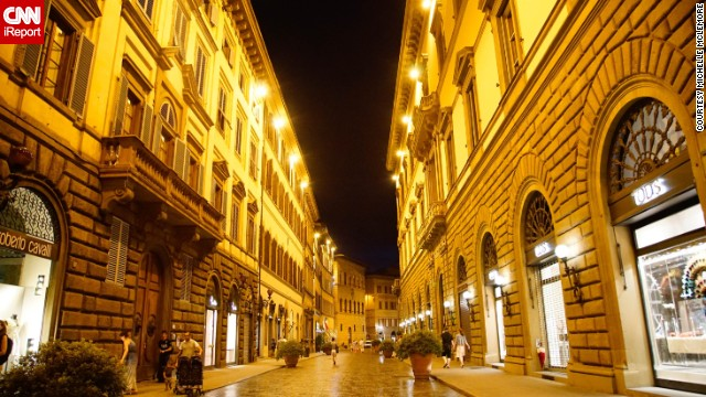 "A Florence, Italy, street glows at night. <a href='http://ireport.cnn.com/docs/DOC-1149875'>Michelle McLemore</a> says Florence has ""retained the charm of a city full of history and culture without becoming too much of a tourist trap."""