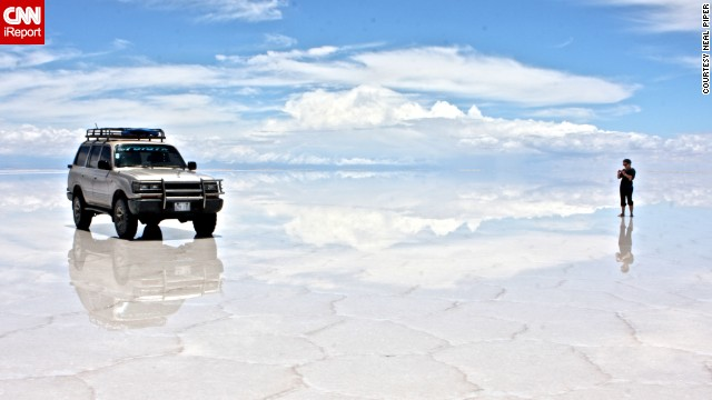 "At Bolivia's otherworldly salt flats, or <a href='http://ireport.cnn.com/docs/DOC-725841'>Salar de Uyuni</a>, it can be hard to distinguish the ground from the sky. ""Out of all of my travels this could be the most amazing place I've ever been,"" said Neal Piper."
