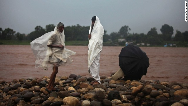 Residents watch water levels rise on the banks of the River Tawi in Jammu on September 4.
