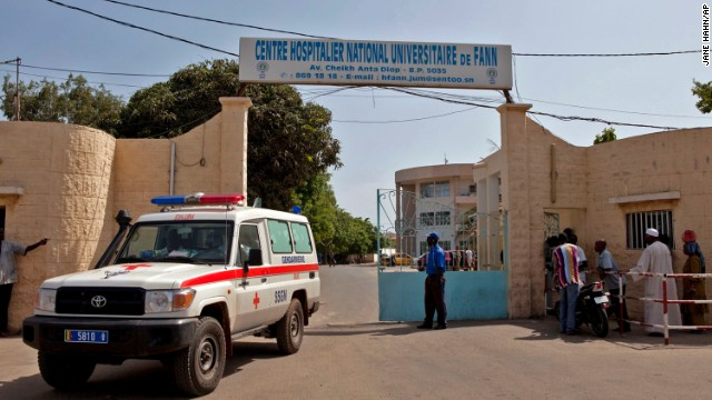 A ambulance leaves the University Hospital Fann in Dakar, Senegal, where a man was being treated for symptoms of the Ebola virus on Friday, August 29.