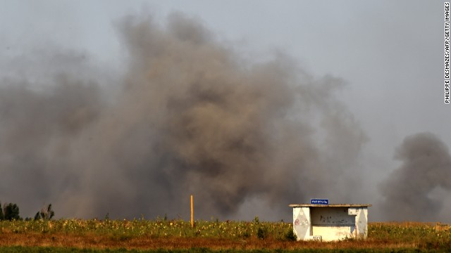 Smoke rises on the outskirts of Mariupol after pro-Russian rebels fired heavy artillery on September 5.