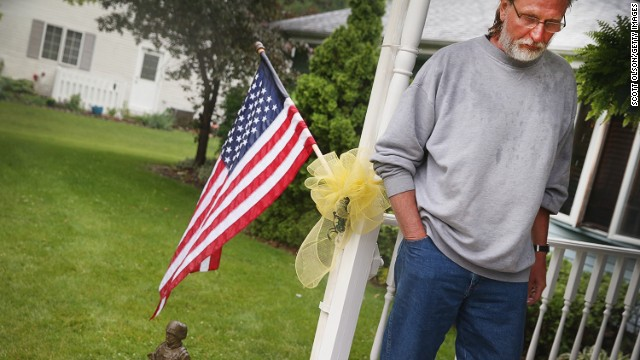 Family of Pvt. 2nd Class Aaron S. Toppen, 19, grieve his death on June 10, 2014 in Mokena, Illinois.