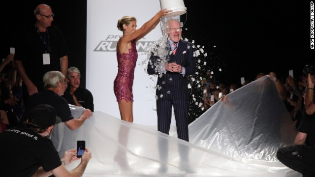 "Heidi Klum, left, and Tim Gunn, right, took part in the ALS Ice Bucket Challenge during the ""Project Runway"" finale at Fashion Week."