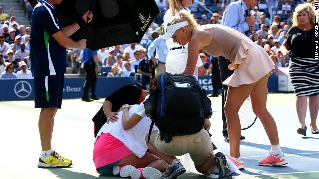 Caroline Wozniacki consoles Peng Shuai, who was forced to retire in the U.S. Open semifinals Friday.